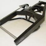 Example from a swingarm with an extra axle ••• Voorbeeld van een achterbrug met tussenas