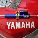 Adapted Hyperpro steering damper for the 2013 Polar Ice Ride R1 ••• Aangepaste Hyperpro-stuurdemper voor de 2013 Poolijs-R1