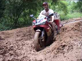 R1. Struggling through the mud in civil war torn Congo, Africa